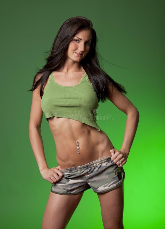 Sexy Vrouw op Groene Achtergrond royalty-vrije stock foto's