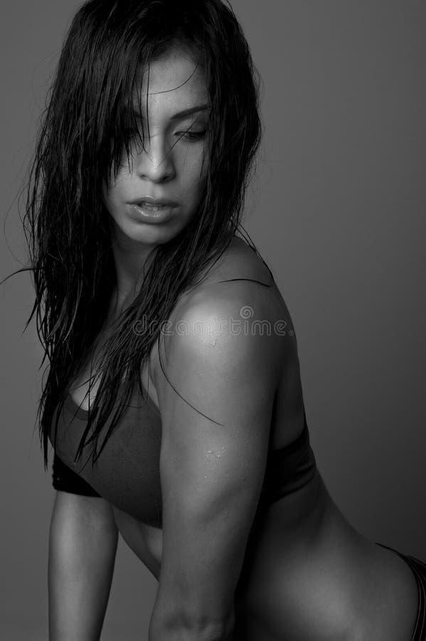 Sexy vrouw in opleidingsbovenkant royalty-vrije stock afbeeldingen