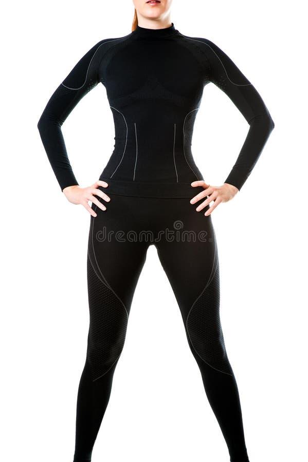 Sexy vrouw in zwart heet sporten thermisch ondergoed stock foto