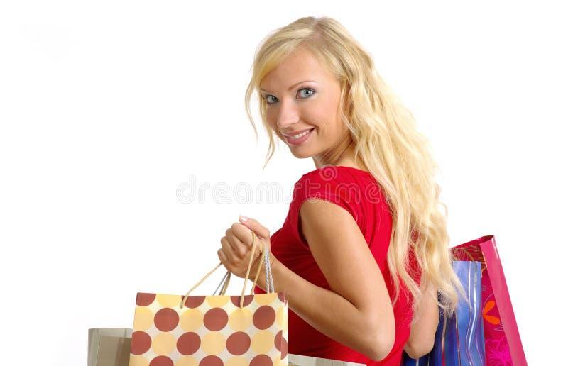 Sexy winkelende vrouw stock afbeeldingen