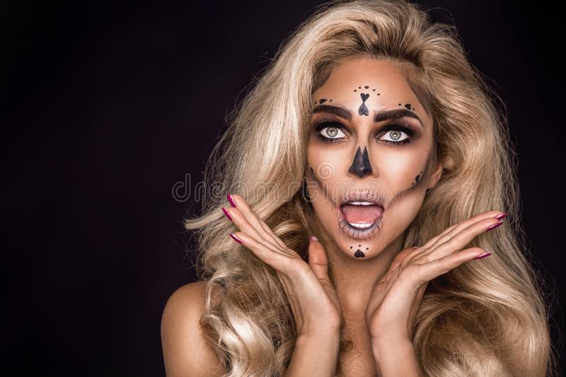 Sexy witch with Halloween skeleton make up - Image. Sexy witch model with Halloween skeleton make up - Image royalty free stock photos