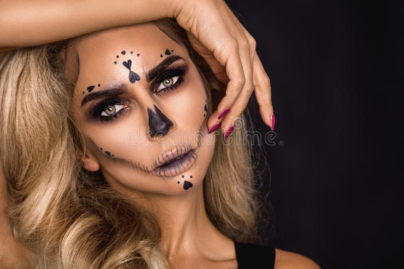 Sexy witch with Halloween skeleton make up - Image. Sexy witch model with Halloween skeleton make up - Image royalty free stock image