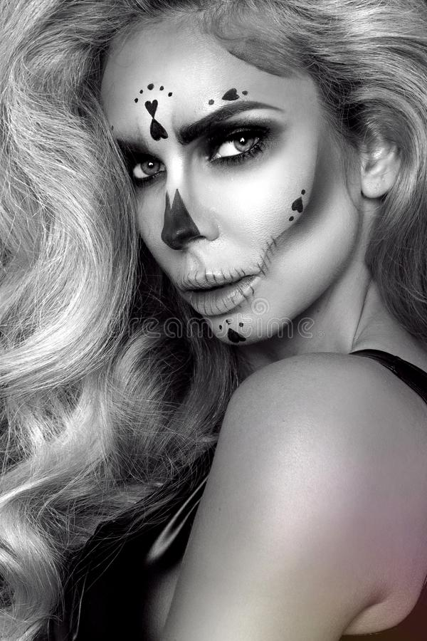 Sexy witch with Halloween skeleton make up - Image. Sexy witch model with Halloween skeleton make up - Image royalty free stock images