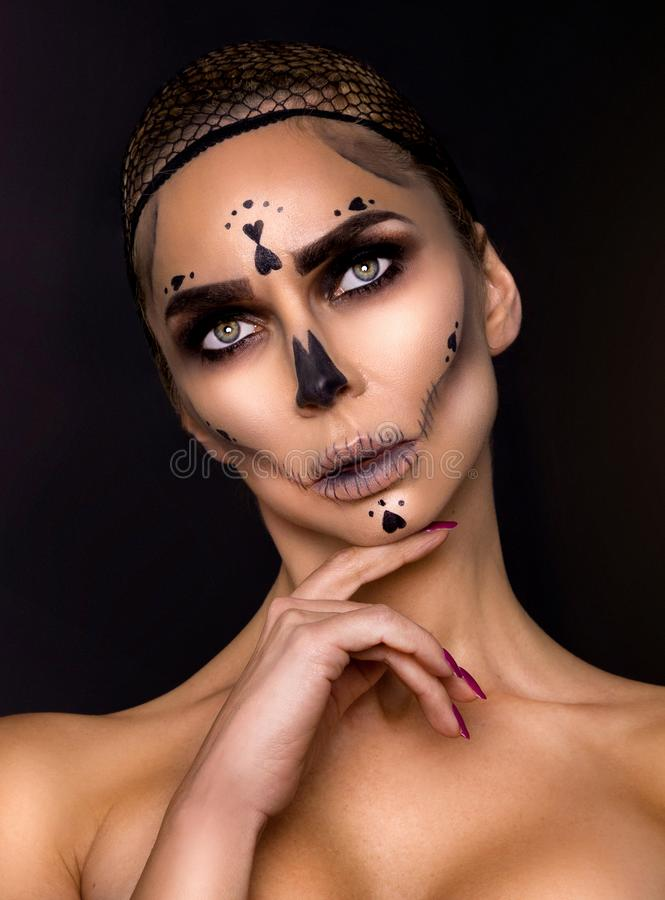 Sexy witch with Halloween skeleton make up - Image. Sexy witch model with Halloween skeleton make up - Image stock photography
