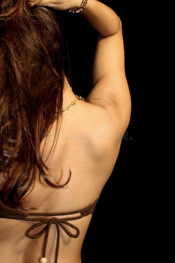 Woman. Detail of a fit womans back shoulder and hair royalty free stock photos