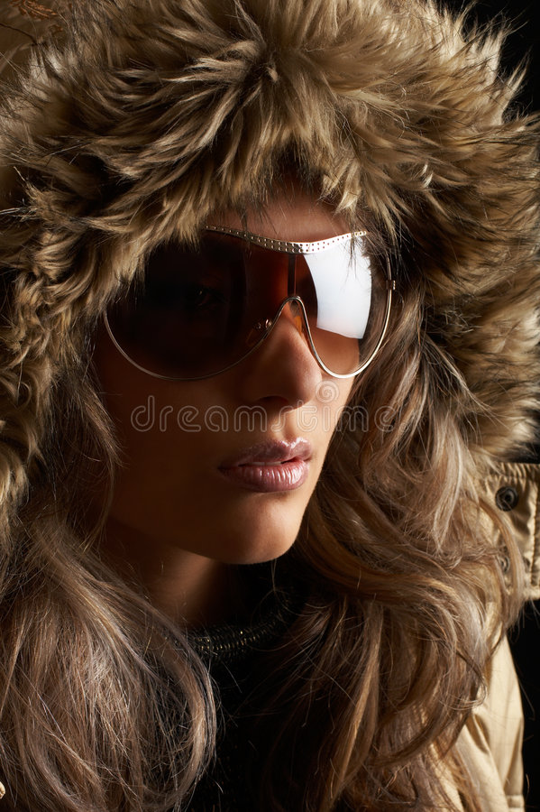 Woman. High fashion shoot - young woman over black background with moody light stock photo