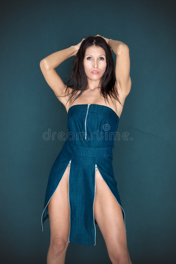 Woman. A woman posing in a glamorous blue dress royalty free stock images