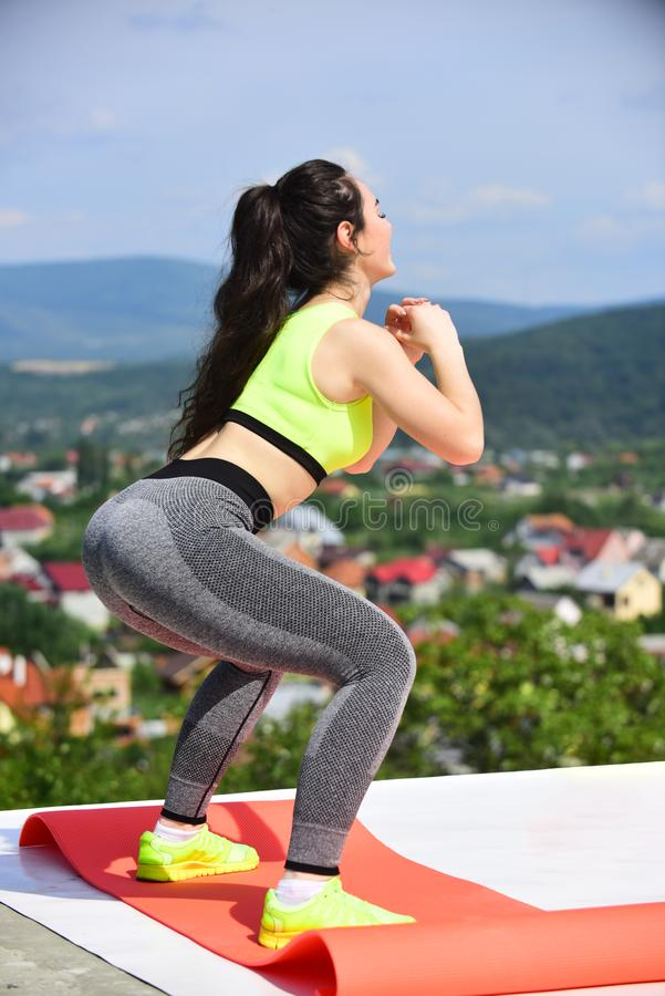 Sexy woman bend knees on natural landscape, training royalty free stock photo