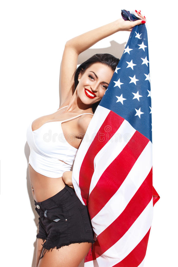 woman with big tits holding USA flag royalty free stock photo
