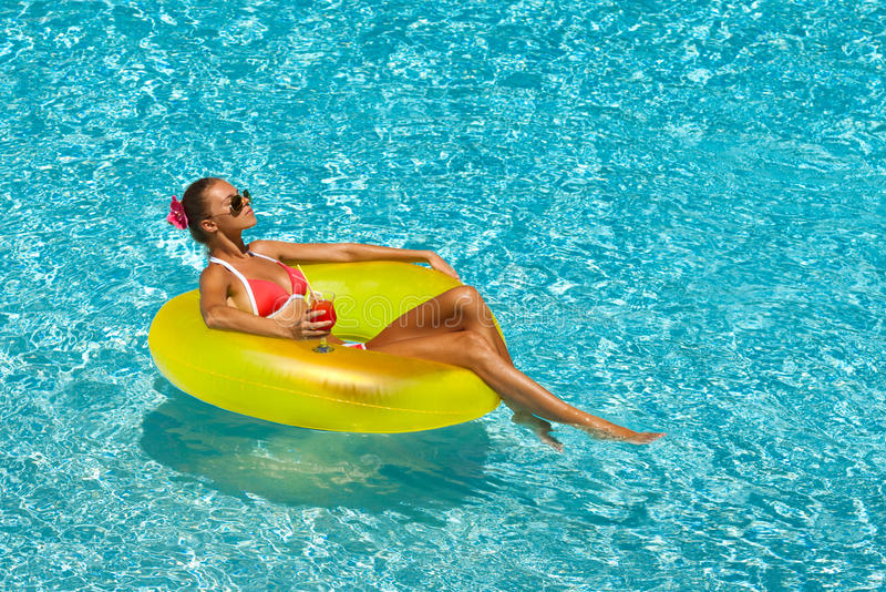 woman in bikini enjoying summer sun and tanning during holidays in pool royalty free stock photos