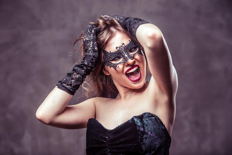 Woman in Black Mask royalty free stock photo