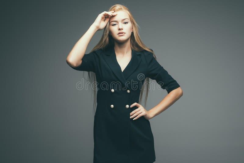 Beautiful woman blond hair wear dress back casual street style model designer grey background stock photos