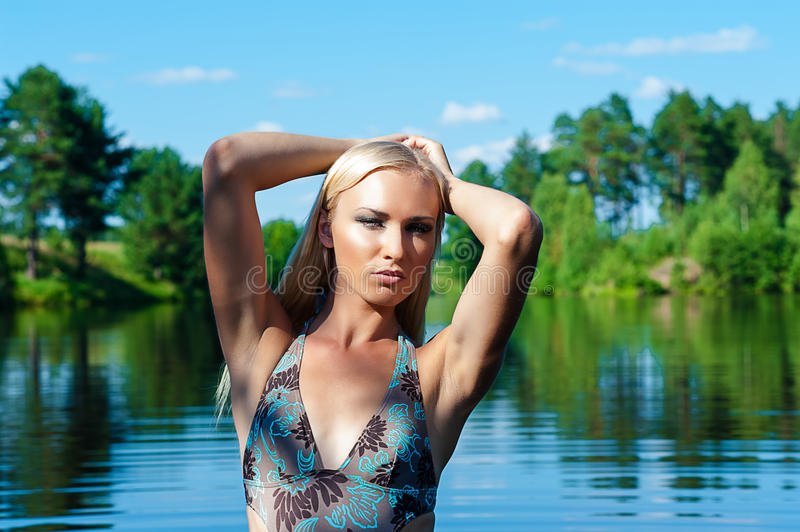 Download Woman in a blue swimsuit stock photo. Image of ecology - 43607444