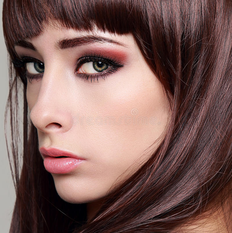 Woman with bright makeup eyes. And long lashes. Closeup stock image