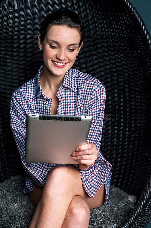 Download Woman Browsing On Touch Pad Device Stock Photo - Image of beauty, glamorous: 37591580