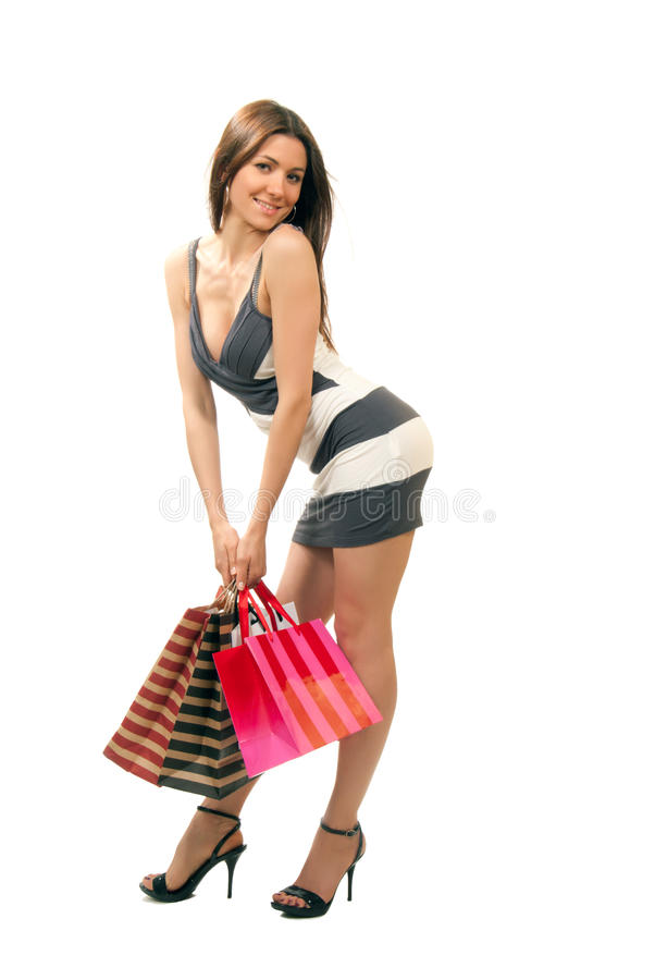woman with colorful gift shopping bags stock photo