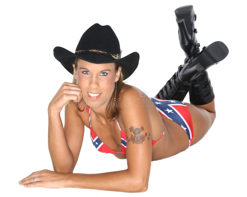 Woman in cowboy hat. Young woman in cowboy hat and boots wearing confederate flag bikini, white background stock images