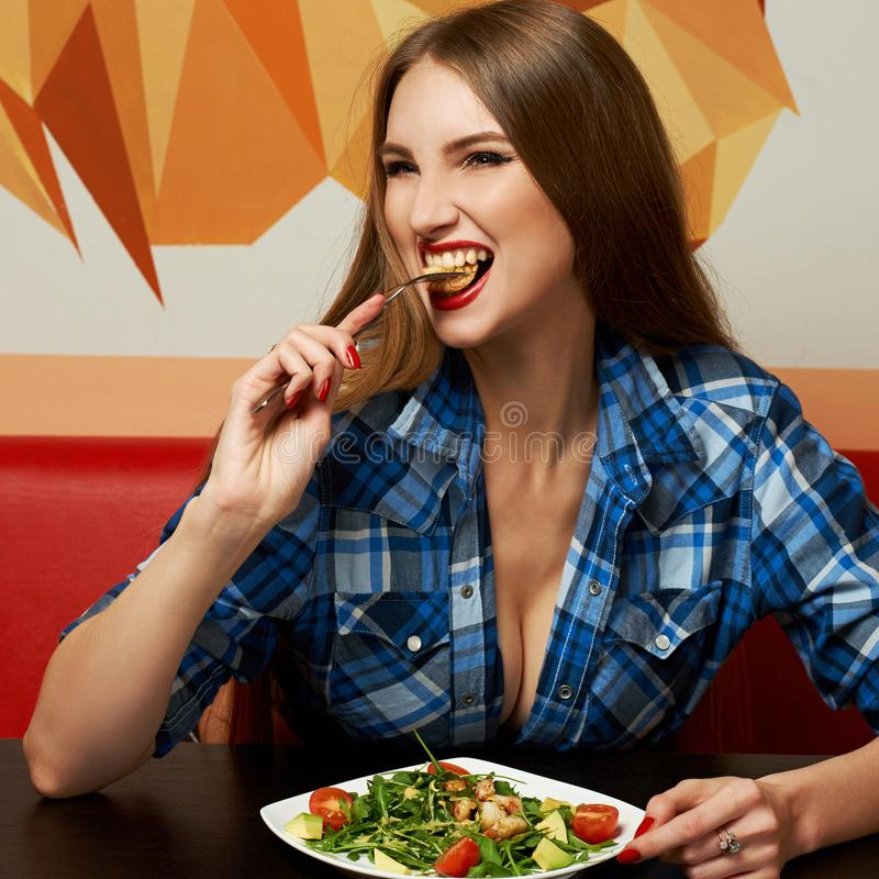 woman dressed in unbuttoned checkered shirt sitting at rest stock photos