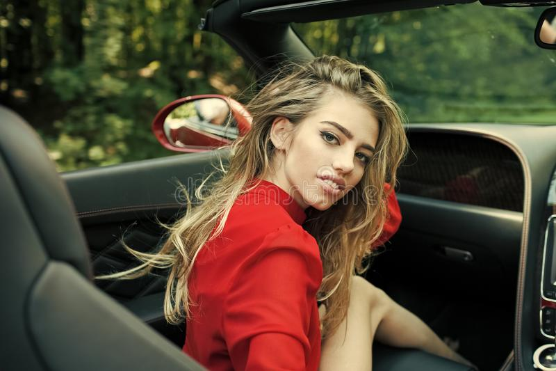 Woman drive car, fashion, beauty. Modern life, luxury, city, glamour. Business trip or commanding, happy girl driver. Businesswoman or pretty woman in stock image