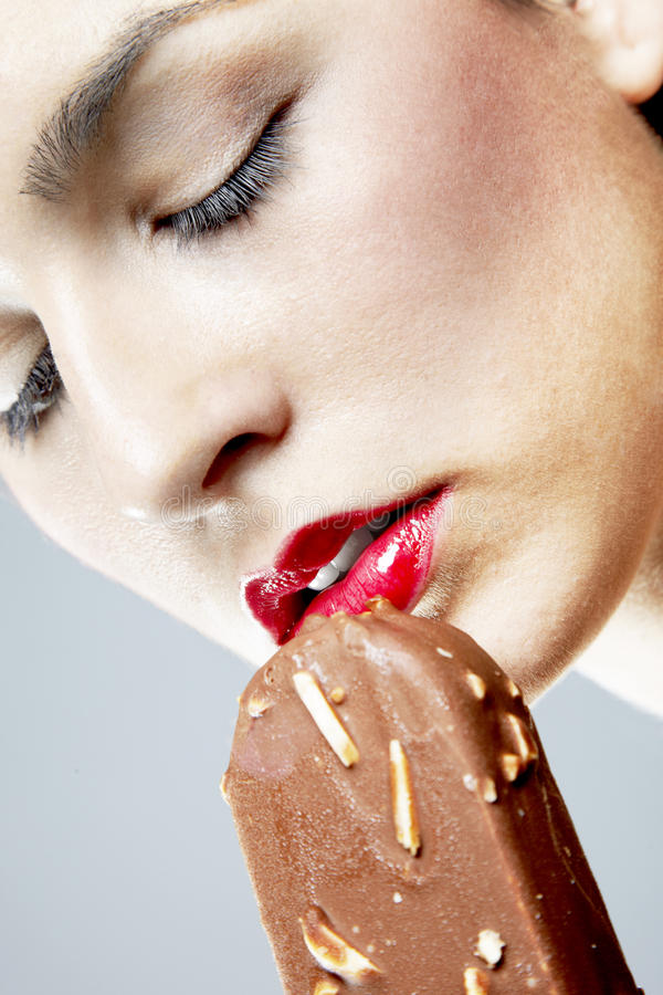 Download Woman Eating Almond Ice Cream Stock Photo - Image: 24620552