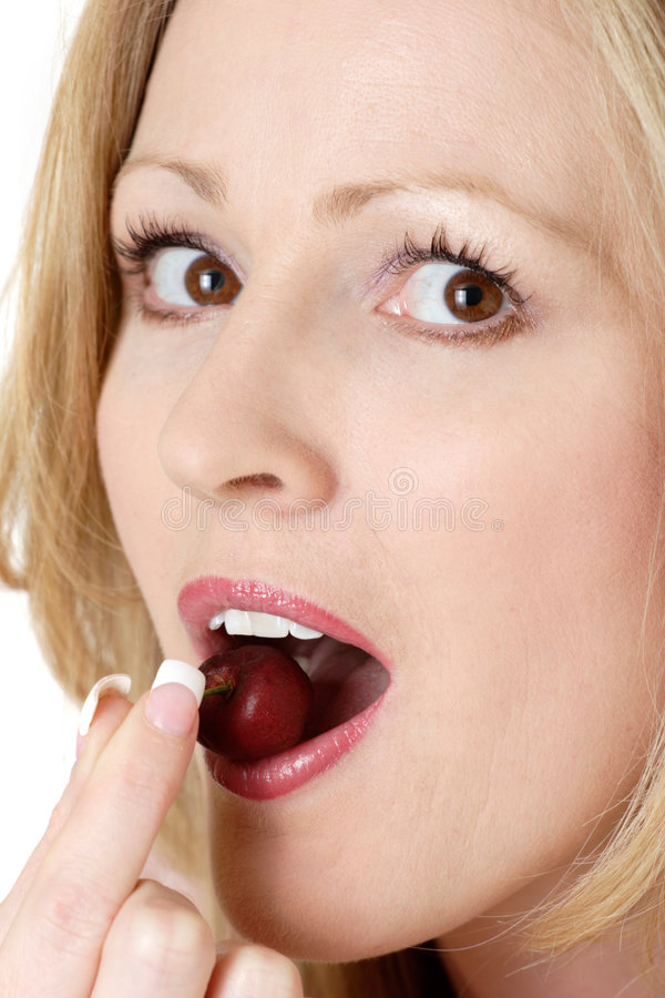Woman Eating A Cherry Stock Photo