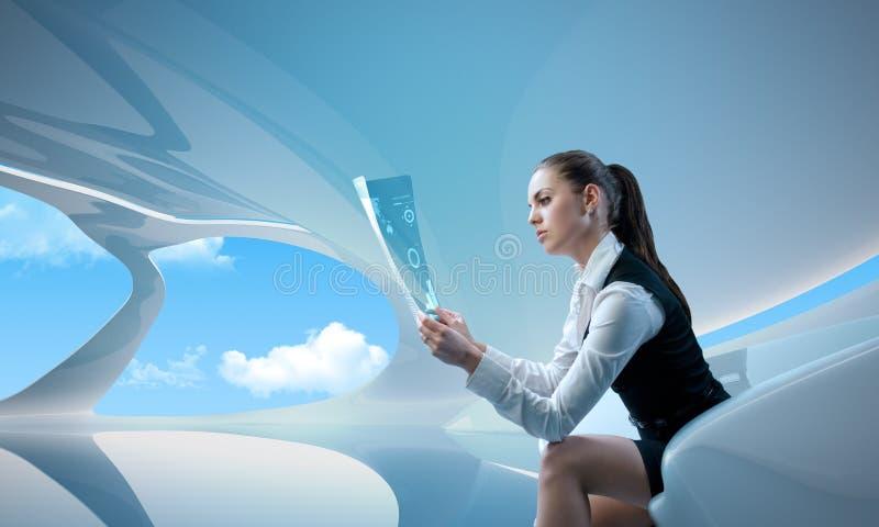 woman examining future digital newspaper stock photography