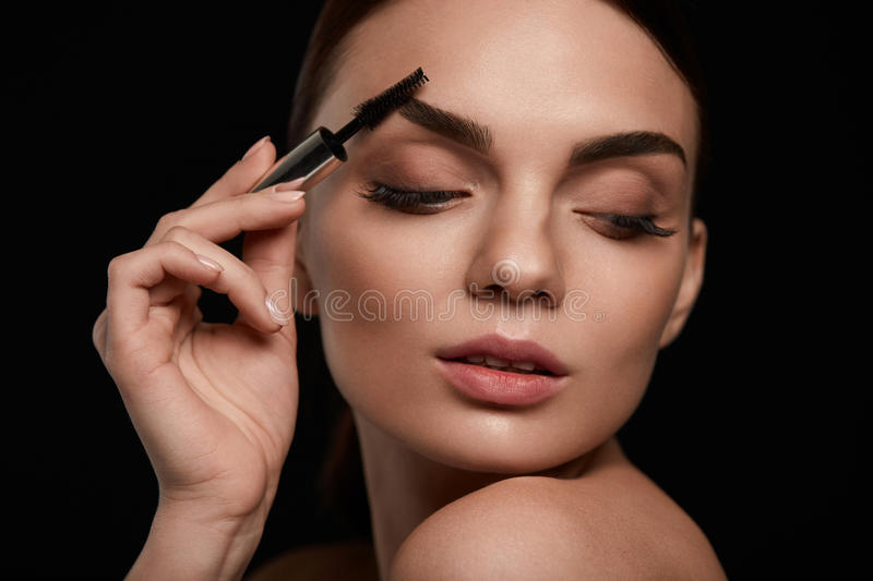 Woman Face With Closed Eyes And Beautiful Eyebrows royalty free stock photos