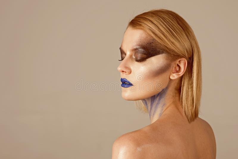 woman with fashion makeup. girl with fashion makeup. Halloween. Beauty salon hairdresser. Hair loss care royalty free stock images