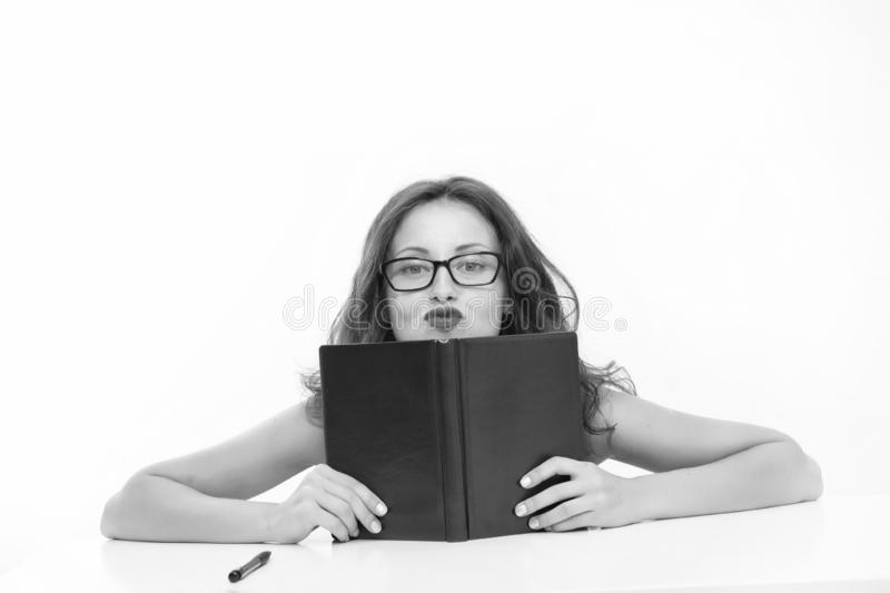 Woman gives lessons of seduction. woman with book. Knowledge of seduction techniques. Lessons for the future. Seductive beauty royalty free stock photography