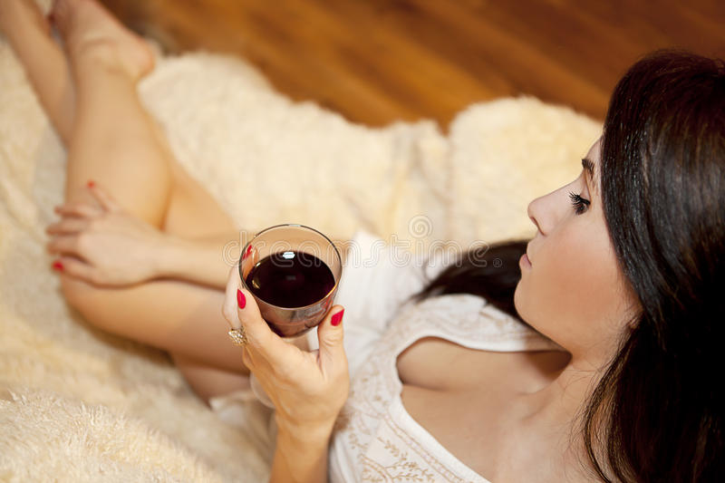 woman with the glass of wine stock image