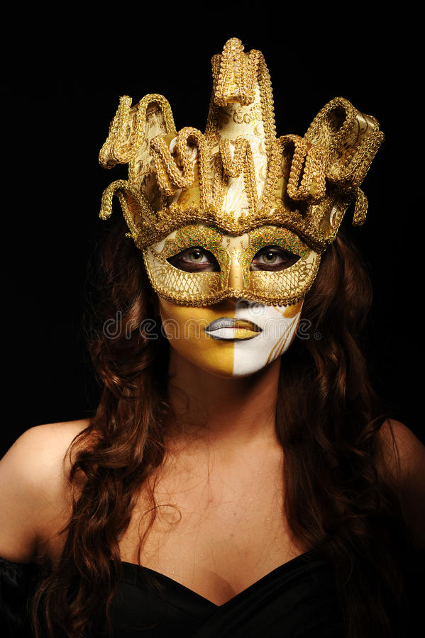Download Woman in golden party mask stock photo. Image of gloomy - 21150048