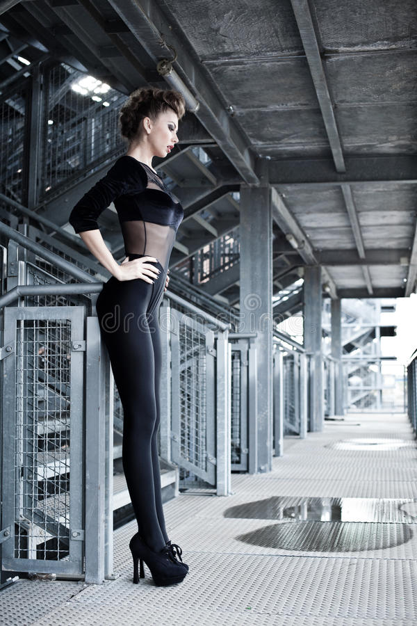 Woman, great body doing a fashion shoot. Woman model, great body doing a fashion shoot in a grunge location royalty free stock image