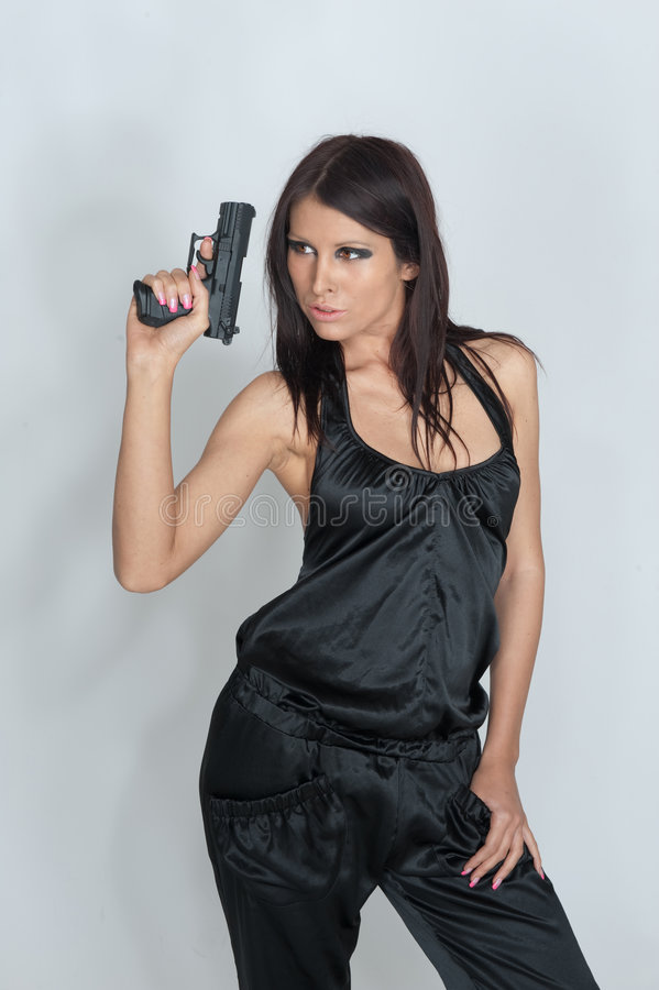 Download Woman Holding Gun Royalty Free Stock Photography - Image: 9211777