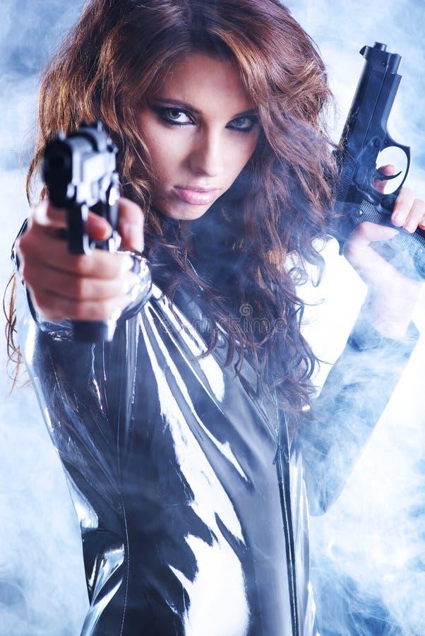 woman holding gun with smoke stock photography