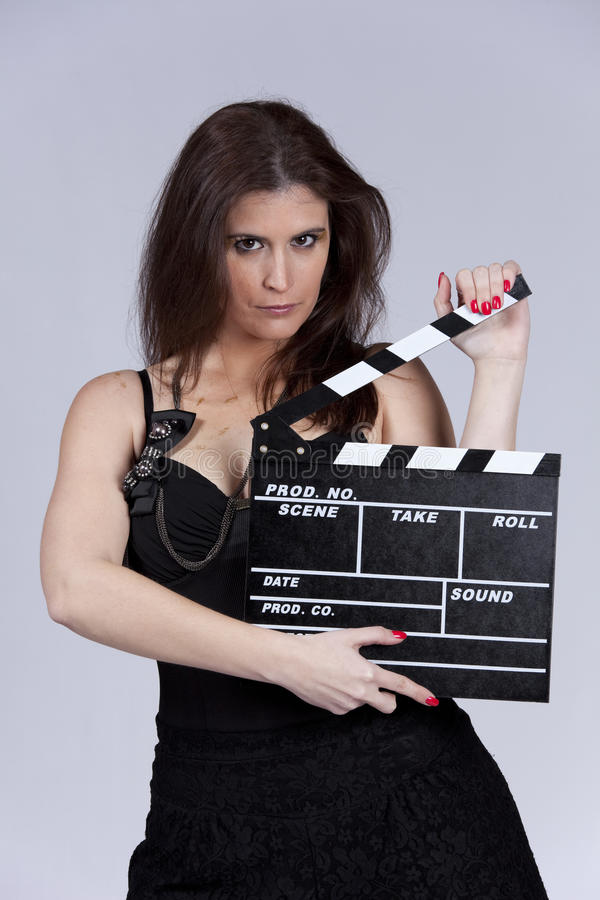 Woman at hollywood. Beautiful woman holding a film slate stock photography