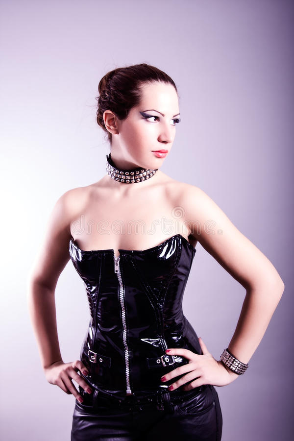 Download Woman With Hourglass Figure In Black Leather Corset Royalty Free Stock Photo - Image: 34423695