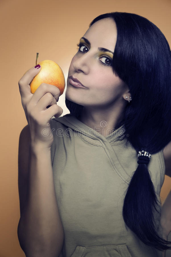 woman kissing an apple stock photography