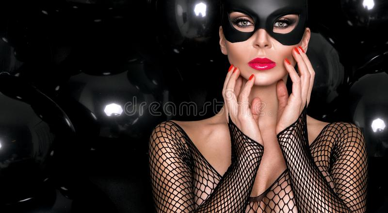 woman with large breasts, wearing a black mask Easter bunny royalty free stock photography