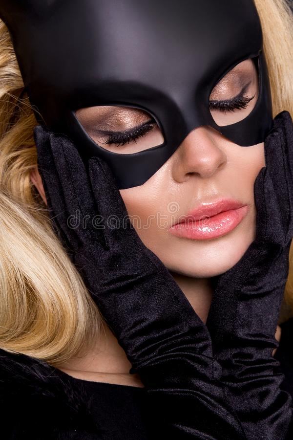 woman with large breasts, wearing a black mask Easter bunny royalty free stock photo