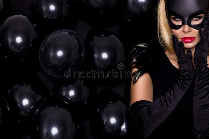 woman with large breasts, wearing a black mask Easter bunny stock photography