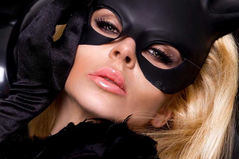 woman with large breasts, wearing a black mask Easter bunny stock photo