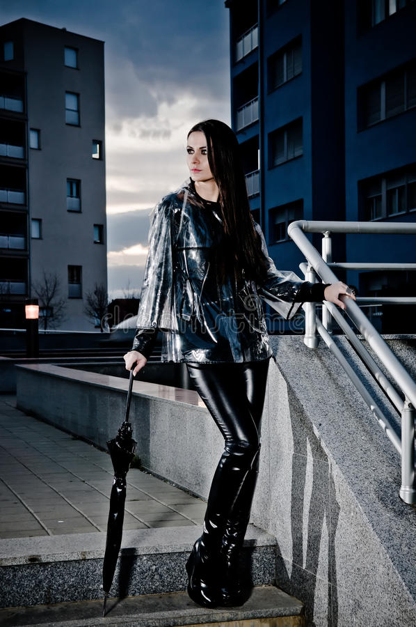Download Woman In Leather And Raincoat Stock Image - Image: 23183909