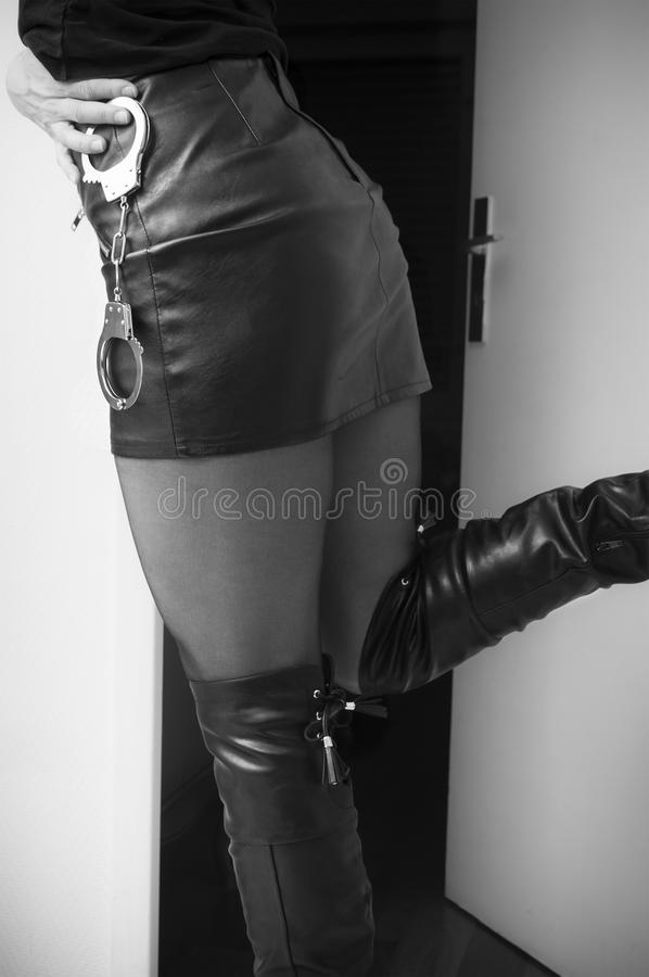 woman with leather skirt and Handcuffs royalty free stock photo