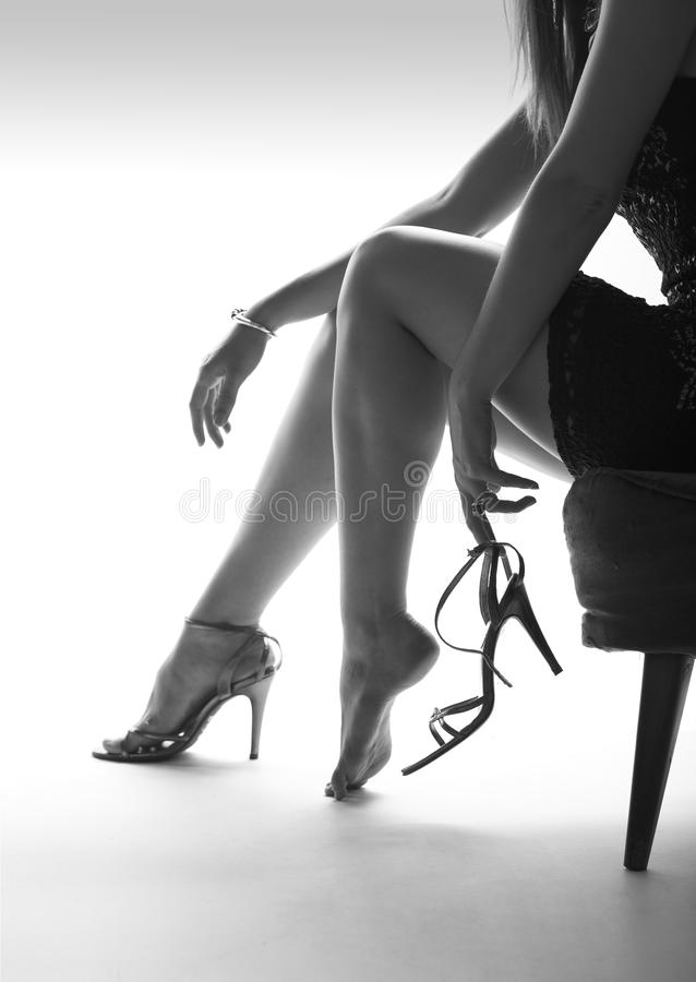 woman legs and high heels, white background royalty free stock photography