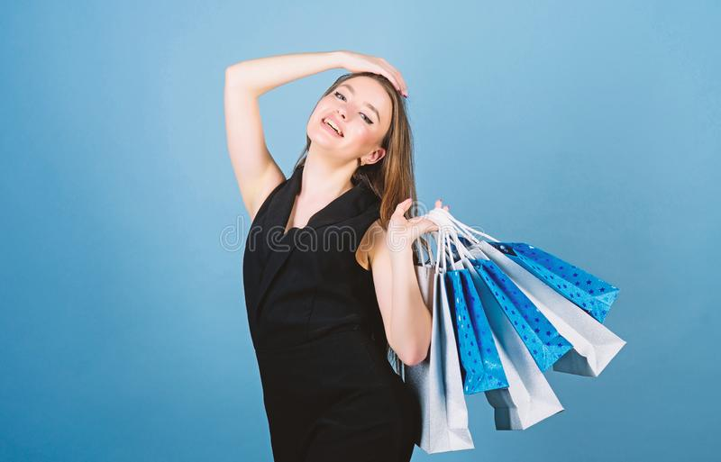 Sexy woman with long hair at shopping. shopping bag. Big sale. sensual woman hold purchase package. fashion and beauty royalty free stock images