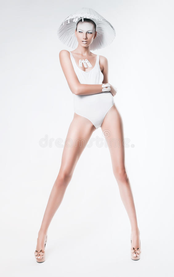 woman with long legs in white hat royalty free stock photography