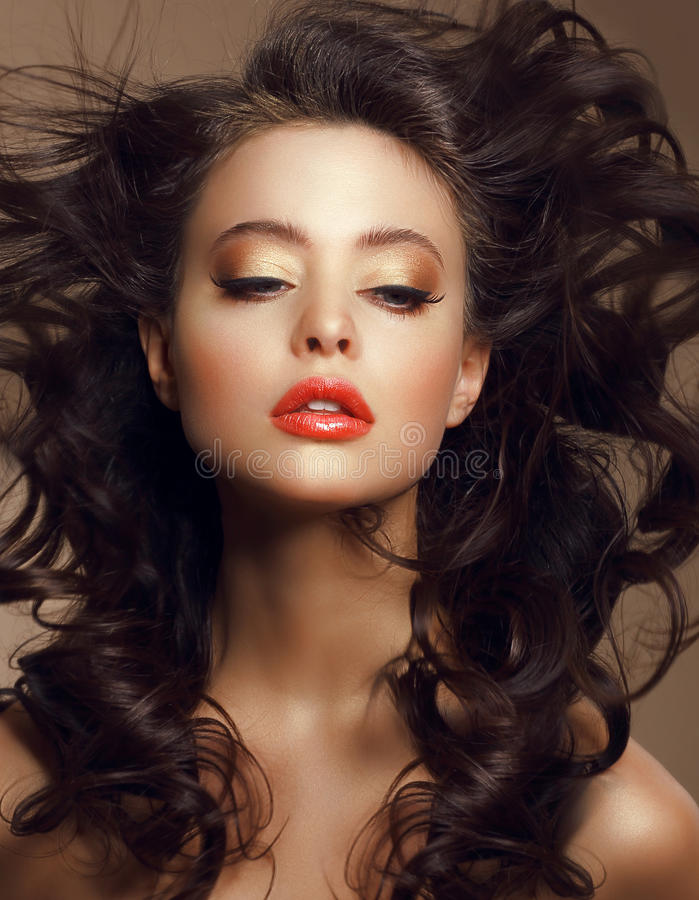 Woman with Long Windy Brown Hair and Saturated Makeup royalty free stock photos