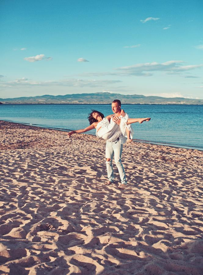woman and man at sea. Family and valentines day. Love relations of couple enjoying summer day together. Couple in stock photo