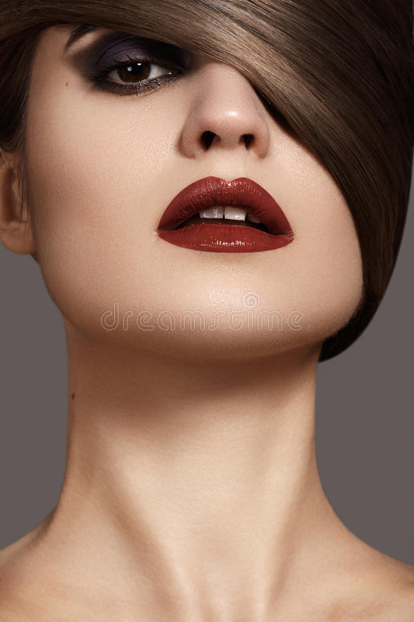 Woman model with dark red lips & smooth hairstyle. Health, beauty, wellness, haircare, cosmetics and make-up. Beautiful woman model with shiny straight long hair stock photos