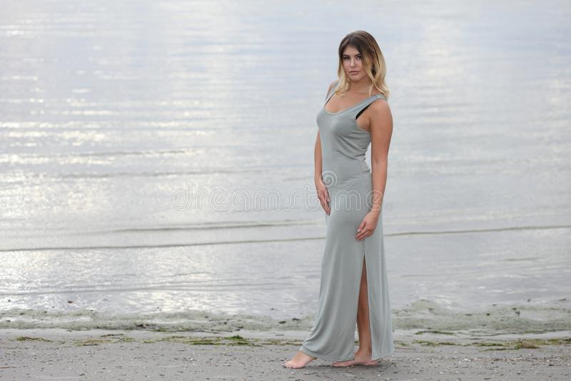 woman on ocean in a dress royalty free stock photo